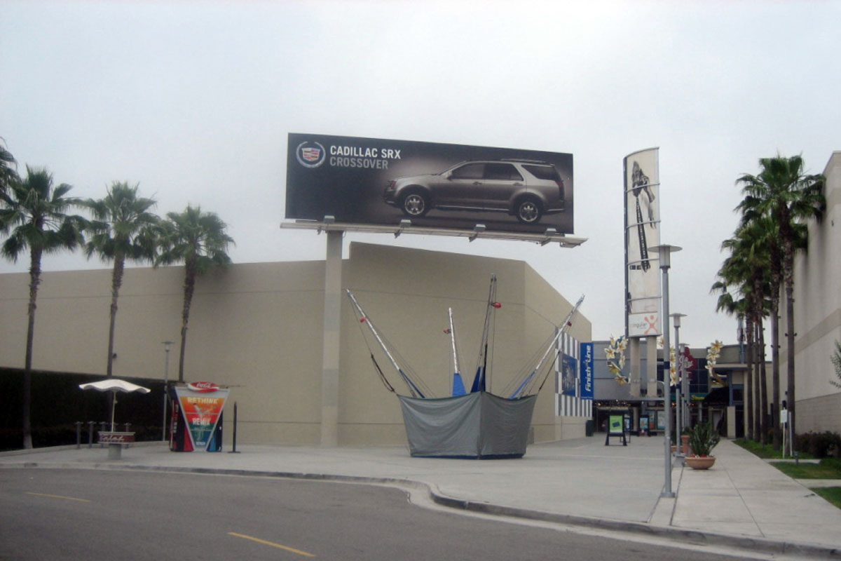 The Outlets - Orange Mall Billboard Ad - Cadillac